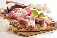 Raw pork on a cutting board. With herbs and spices Royalty Free Stock Photography