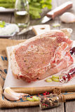 Raw pork on a cutting board Royalty Free Stock Photos