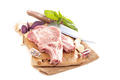 Raw pork on a cutting board. Isolated on white Royalty Free Stock Photo