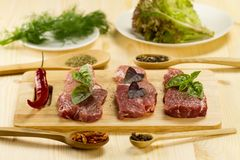 Raw pork on cutting Board with spices and herbs Royalty Free Stock Photos