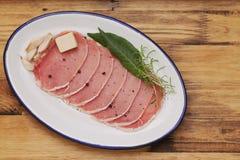 Raw pork on dish with bay leaf, black pepper Royalty Free Stock Photo