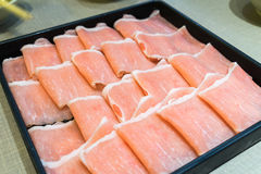 Raw pork in the dish wait to get down boiling in hot pot Royalty Free Stock Image