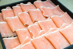 Raw pork in the dish wait to get down boiling in hot pot Royalty Free Stock Photo