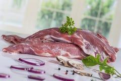 Raw pork, filet mignon, with oignion, fresh herbs,. Raw porkfilet mignon ready to cook with seasonning stock photos
