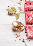 Raw pork fillet with herbs and spices in vintage spoon Royalty Free Stock Image