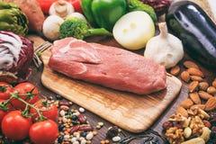 Raw pork fillet on wooden background Stock Image