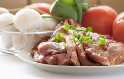 Raw pork with fresh, vegetables. Stock Photos