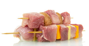 Raw pork, fresh vegetables and mushrooms on wooden skewers isolated. Stock Photo