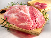 Raw pork ham on cutting board Stock Image