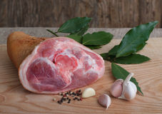 Raw pork knuckle with pepper. garlic and bay leaves. The Raw pork knuckle with pepper. garlic and bay leaves Stock Images