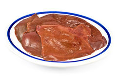 Raw pork liver in plate. On white background Royalty Free Stock Photo