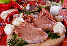 Raw pork loin chops on chopping board Royalty Free Stock Photo