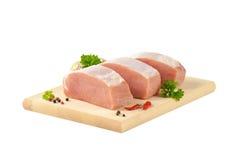 Raw pork loin. Slices of fresh boneless pork loin on cutting board Stock Photo