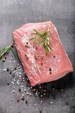 Raw pork loin with spices.  Royalty Free Stock Image