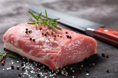 Raw pork loin with spices.  Stock Image