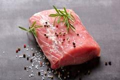 Raw pork loin with spices.  Stock Photos
