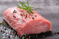 Raw pork loin with spices.  Royalty Free Stock Images