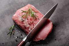 Raw pork loin with spices. And cuting knife Stock Photos