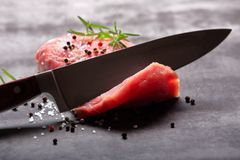 Raw pork loin with spices. And cuting knife Stock Images