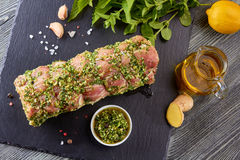 Raw pork loin with spices ready for baking Stock Photos