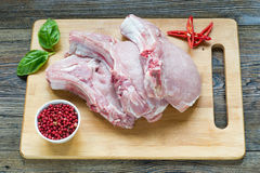 Raw Pork Loin Steaks on cutting board Royalty Free Stock Photo