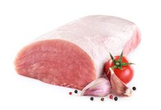 Raw pork loin with tomato, pepper and garlic. Isolated on white background. Fresh meat Royalty Free Stock Photo