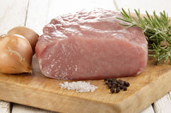 Raw pork loin on a wooden board Royalty Free Stock Photos