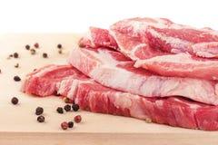 Raw pork meat on board. Raw pork meat on cutting board Stock Photography