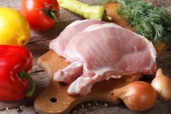 Raw pork meat closeup and fresh vegetables horizontal Royalty Free Stock Images