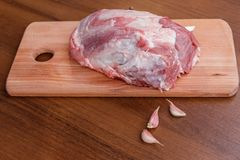 Raw pork meat on cutting board on table. Raw pork meat on cutting board on a table Royalty Free Stock Photography