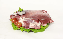 Raw pork meat on decorative salad. And other vegetables Stock Photo