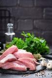 Raw pork meat, filet. On board Stock Photos