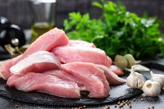 Raw pork meat, filet. On board Royalty Free Stock Photo