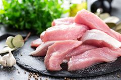 Raw pork meat, filet. On board Royalty Free Stock Image