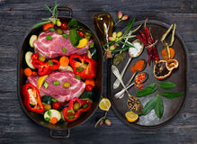 Raw pork meat and fresh vegetables, spices Royalty Free Stock Photos