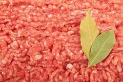 Raw pork meat. Ground beef with bay leaf Stock Photo