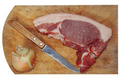 Raw pork meat, knife and onion on cutting board.Isolated.Top vie Stock Images
