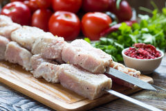 Raw pork meat, making kebab. Skewers ready for grilling Stock Image