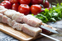 Raw pork meat, making kebab. Skewers ready for grilling Royalty Free Stock Photography