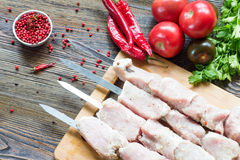 Raw pork meat, making kebab. Skewers ready for grilling Royalty Free Stock Images