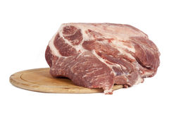 Raw pork meat on a round board Royalty Free Stock Images