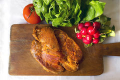 Raw pork meat seasoned for cooking Royalty Free Stock Photos