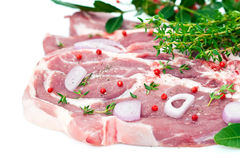 Raw pork meat and seasoning Stock Images