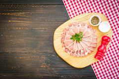 Raw pork meat slice. On wood cutting board - FIlter Processing Royalty Free Stock Image