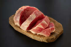 Raw pork meat. Slices on cutting board. Close up steak stock images