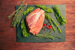 Raw pork meat with spices on slate stone kitchen board.  Royalty Free Stock Image