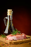 Raw pork meat steak and olive oil Royalty Free Stock Photos