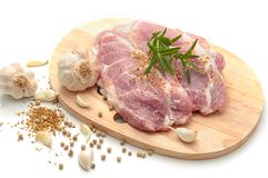 Raw pork meat steaks with spices. On wooden chopping board Stock Images