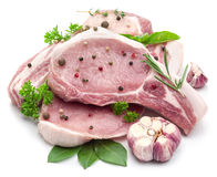 Raw pork meat steaks with spices. Royalty Free Stock Image