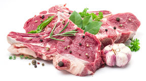 Raw pork meat steaks with spices. Stock Image